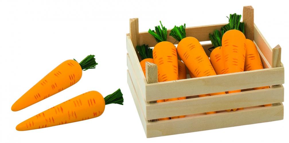 Houten wortelen in kist