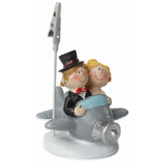 Kaarthouder bruidspaar in vliegtuig