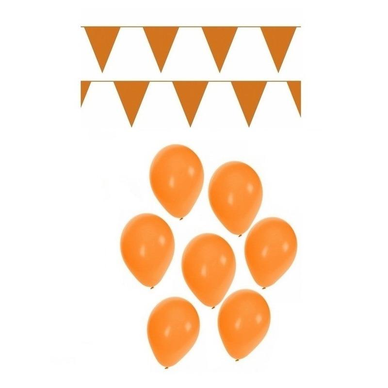 Koningsdag versiering met oranje slingers en ballonnen